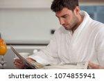 young freelancer in bathrobe... | Shutterstock . vector #1074855941