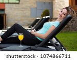 woman relaxing on lounger in... | Shutterstock . vector #1074866711