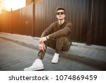 handsome fashion hipster man in ... | Shutterstock . vector #1074869459