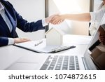 handshake after good... | Shutterstock . vector #1074872615