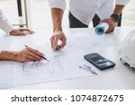 architect or engineer meeting... | Shutterstock . vector #1074872675