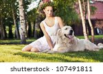 Smiling woman with dog - stock photo