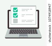 online checklist on laptop... | Shutterstock .eps vector #1074918947