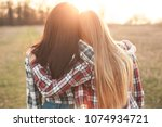two young woman looking on the... | Shutterstock . vector #1074934721