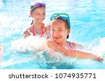two cute girls playing in... | Shutterstock . vector #1074935771