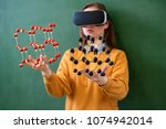 female student wearing virtual... | Shutterstock . vector #1074942014