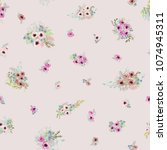 seamless ditsy pattern in small ... | Shutterstock . vector #1074945311