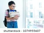 portrait of sad child while... | Shutterstock . vector #1074955607