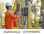production operator operating... | Shutterstock . vector #1074958091