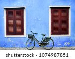 bicycle with metal basket... | Shutterstock . vector #1074987851