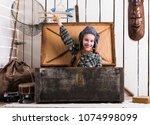 two playful little girls... | Shutterstock . vector #1074998099