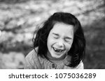girl laughing loudly  | Shutterstock . vector #1075036289