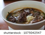 beef chinese noodle soup  | Shutterstock . vector #1075042547