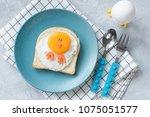 funny egg toast for kids on... | Shutterstock . vector #1075051577