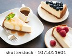 assortment of cheesecakes with... | Shutterstock . vector #1075051601