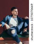 handsome young man posing in...   Shutterstock . vector #1075070669