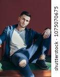 handsome young man posing in...   Shutterstock . vector #1075070675
