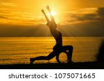 silhouette of woman practicing...   Shutterstock . vector #1075071665
