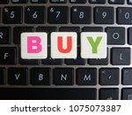 word buy on keyboard background   Shutterstock . vector #1075073387
