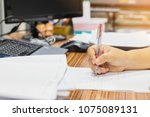 teacher is checking on student... | Shutterstock . vector #1075089131