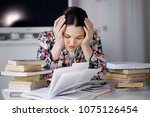 a young woman sits in front of... | Shutterstock . vector #1075126454
