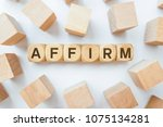 Small photo of AFFIRM word on wooden cubes