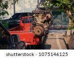 old or used car engine hanging... | Shutterstock . vector #1075146125
