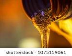 liquid stream of motorcycle... | Shutterstock . vector #1075159061
