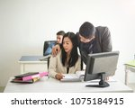 businessman sexually harassing... | Shutterstock . vector #1075184915
