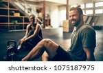 fit young people in exercise... | Shutterstock . vector #1075187975
