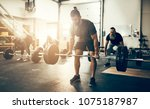 fit and focused young man in... | Shutterstock . vector #1075187987