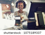 smiling young african waitress... | Shutterstock . vector #1075189337