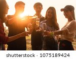 Small photo of Six young entrepreneur gathering together toast for success in business start up, group party at dusk