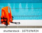 life jackets in the pool. | Shutterstock . vector #1075196924