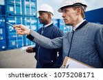 two engineers wearing hardhats... | Shutterstock . vector #1075208171