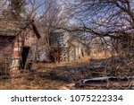 an old neglected farm and... | Shutterstock . vector #1075222334