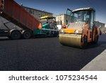 heavy asphalt paver red truck...   Shutterstock . vector #1075234544