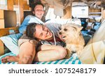 hippie couple with funny dog...   Shutterstock . vector #1075248179