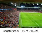 blurred background of football... | Shutterstock . vector #1075248221