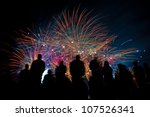 big fireworks with silhouettes... | Shutterstock . vector #107526341