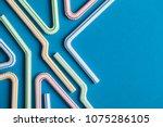 plastic straws on a blue...   Shutterstock . vector #1075286105