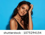 young sexy slim tanned woman in ... | Shutterstock . vector #1075294154