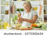 grandmother cook in the kitchen | Shutterstock . vector #1075300634