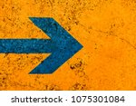Blue arrow direction sign over...