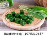 Frozen Greens Cubes On A Wooden ...