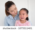 pretty mother soothing and... | Shutterstock . vector #1075311401