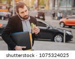 busy man is in a hurry  he does ... | Shutterstock . vector #1075324025