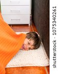 playful child is hiding under... | Shutterstock . vector #1075340261