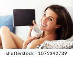 happy woman relaxing at home... | Shutterstock . vector #1075342739