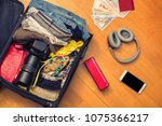 a suitcase with things and a...   Shutterstock . vector #1075366217